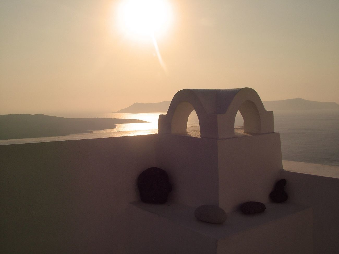sunset over mediterranean santorini