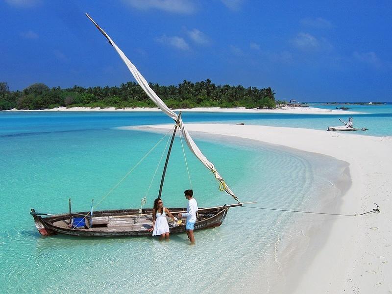 boat and paradise beach maldives